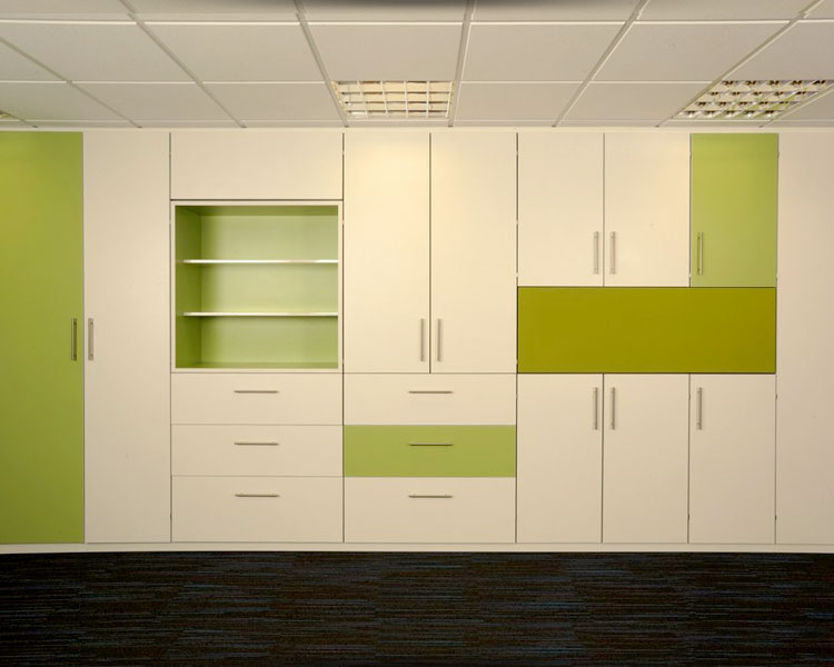 Fitted storage wall with multi-coloured doors.